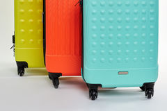Cropped image of wheeled suitcases. Stock Photo