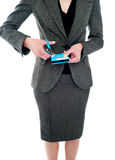 Cropped image of woman destroying credit card Royalty Free Stock Photo