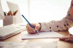 Cropped image of woman drawing Stock Photography