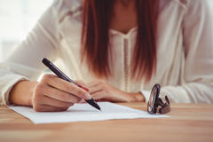 Cropped image of woman drawing Royalty Free Stock Image