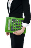 Cropped image of a woman holding big calculator Royalty Free Stock Images