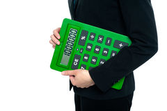 Cropped image of a woman holding calculator. Female executive on white background posing with a large green calculator stock illustration