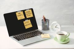 Cropped image of woman holding paper sticker with word ideas near laptop.  royalty free stock photography