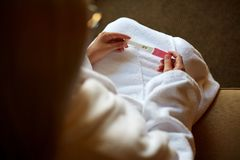 Cropped image of woman holding a pregnancy test on her knees royalty free stock photos