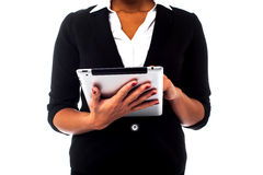 Cropped image of a woman holding touch pad Stock Photo