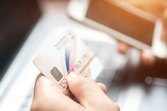 Cropped image of woman inputting card information while shopping Royalty Free Stock Photography