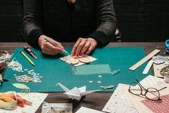 Cropped image of woman making scrapbooking. Greeting postcard royalty free stock image