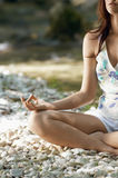 Cropped Image Of Woman Meditating In Lotus Position Royalty Free Stock Photography