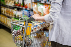 Cropped image of woman pushing trolley Royalty Free Stock Photo