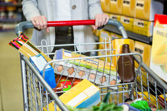 Cropped image of woman pushing trolley Stock Photos