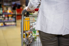 Cropped image of woman pushing trolley Stock Photography
