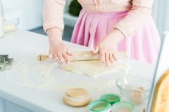 cropped image of woman rolling dough with rolling pin royalty free stock photography