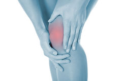 Cropped Image Of Woman Suffering From Knee Pain Stock Image
