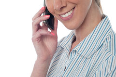 Cropped image of a woman using cellphone Royalty Free Stock Images