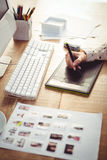 Cropped image of woman using graphics tablet Stock Images