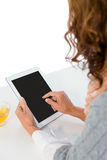 Cropped image of woman using tablet Stock Photo