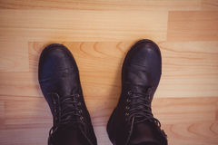 Cropped image of woman wearing boots Royalty Free Stock Photo
