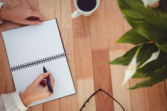 Cropped image of woman writing on notepad Royalty Free Stock Photo