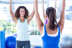 Cropped image of women with arms raised in fitness studio Stock Photos