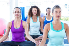 Cropped image of women doing easy pose in fitness center Stock Photos