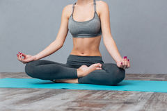 Cropped image of a young beautiful girl practicing yoga Royalty Free Stock Photography