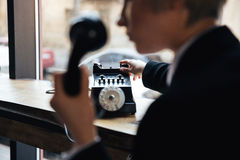 Cropped image of young beautiful woman with telephone Royalty Free Stock Images