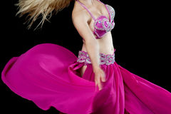 Cropped image of a young belly dancer. Belly dancer wearing fashionable pink dress Royalty Free Stock Images