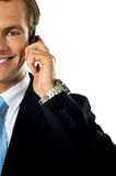 Cropped image of young businessman talking Royalty Free Stock Image