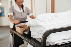 Cropped image of a young hotel maid bringing clean towels Royalty Free Stock Photo
