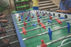 Cropped image of young people playing foosball while resting stock photo