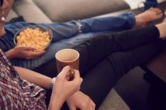 REsting at home. Cropped image of young people resting of sofa at home Stock Photo