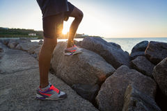 Cropped image of a young sportmen legs in sneakers Stock Image