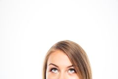 Cropped image of a young woman looking up Royalty Free Stock Images