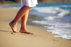 Cropped image of a young woman walking on a beach Royalty Free Stock Image