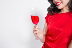 Cropped images of young celebrating asian woman in red dress holding wine glass. stock photography