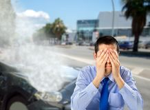 I have no insurance car. Cropped of man with hands on his face lamenting not having car insurance after an accident in the city Royalty Free Stock Photos