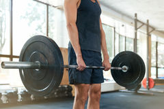 Cropped photo of athletic man. With barbell royalty free stock image