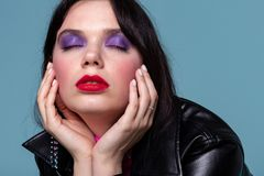 Cropped photo of beautiful model with colorful makeup stock images