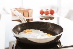 Cropped photo of delicious homemade scrambled eggs, cooked on fr. Cropped photo of delicious homemade scrambled eggs cooked on frying pan royalty free stock photos