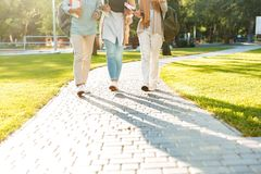 Cropped photo of friends muslim sisters women walking outdoors royalty free stock photo