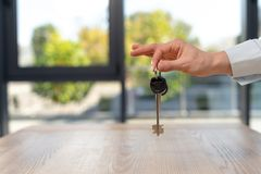 Woman holding key from new flat in hand stock photo