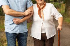 Cropped photo of a senior mother with her son on a walk royalty free stock image