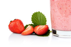 Cropped photo several sliced strawberries leaf juice isolated Royalty Free Stock Images