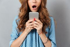 Cropped photo of shocked young caucasian lady chatting royalty free stock images