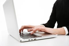 Cropped photo of young business woman using laptop computer. royalty free stock photography