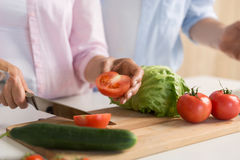 Cropped picture of mature loving couple family cooking. royalty free stock photography
