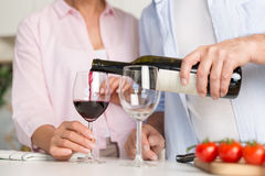 Cropped picture of mature loving couple family drinking wine stock photos