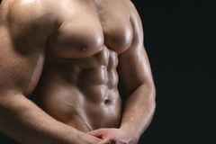Cropped picture of muscle man. Posing in studio over dark background royalty free stock photography