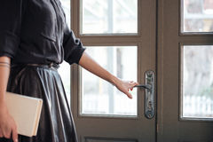 Cropped picture of young beautiful lady open the door Royalty Free Stock Images