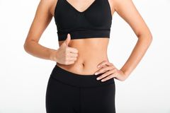 Cropped picture of young sports woman showing thumbs up. Stock Photography